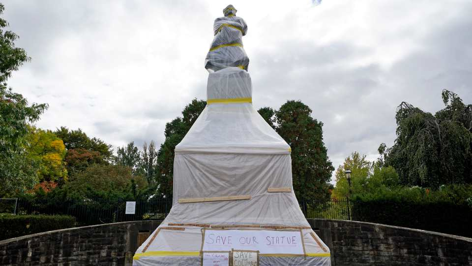 This is a statue of Christopher Columbus in the Oakland neighborhood of Pittsburgh that was wrapped to protect it from vandalism, Monday, Oct. 12, 2020.