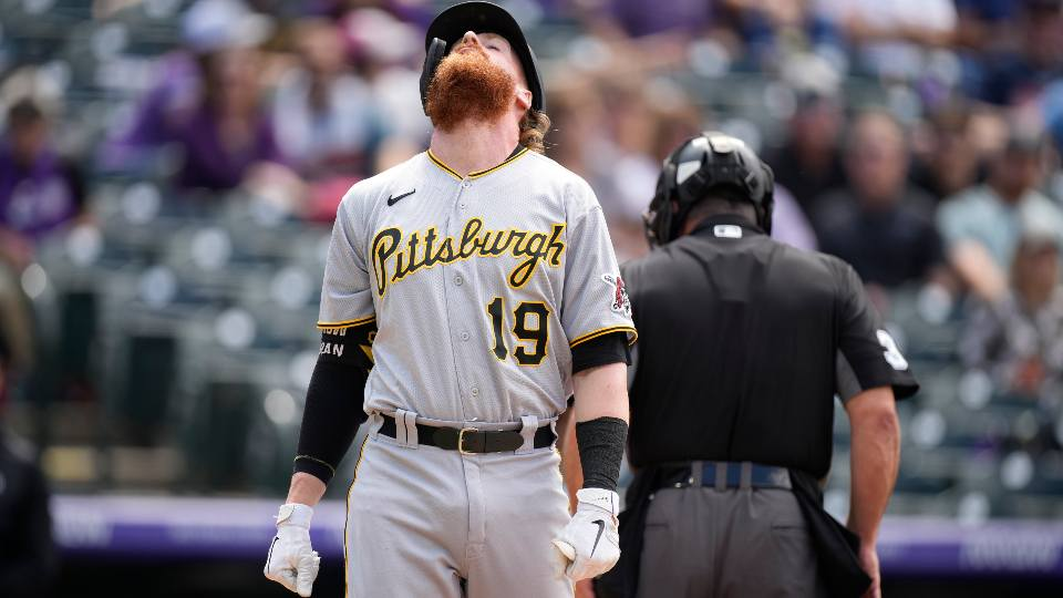 Pittsburgh Pirates' Colin Moran reacts after taking a pitch to the hand from Colorado Rockies starter Kyle Freeland in the first inning of a baseball game Monday, June 28, 2021, in Denver.