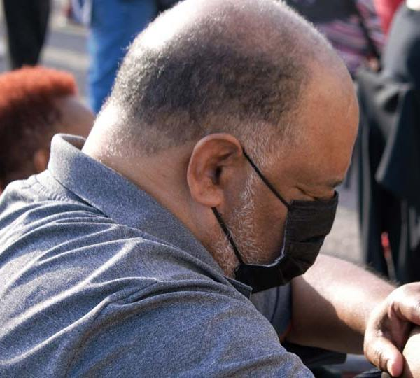 A man is deep in prayer Wednesday during a prayer vigil at the former Bottom Dollar on Glenwood Avenue that was held to kick off an anti violence campaign in the city (WKBN Photo/Joe Gorman)