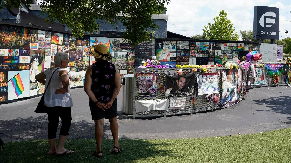 Visitors pay tribute to the display outside the Pulse nightclub memorial Friday, June 11, 2021, in Orlando, Fla. Saturday will mark the fifth anniversary of the mass shooting at the site.