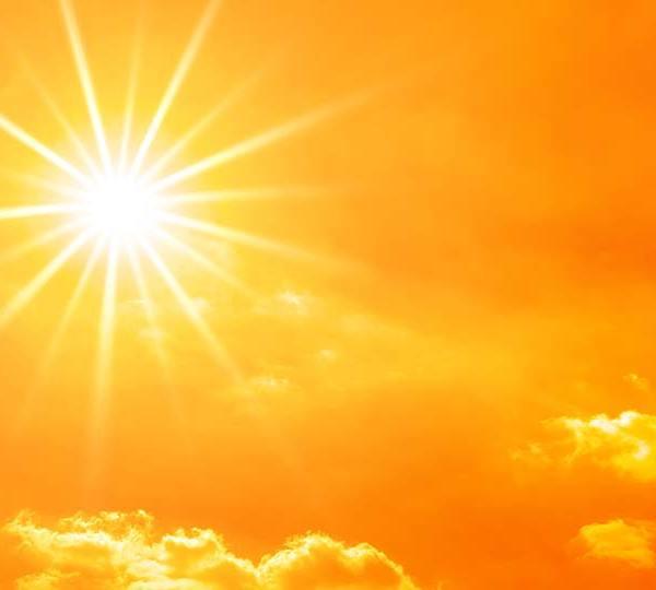 The sun shining on a hot summer day.