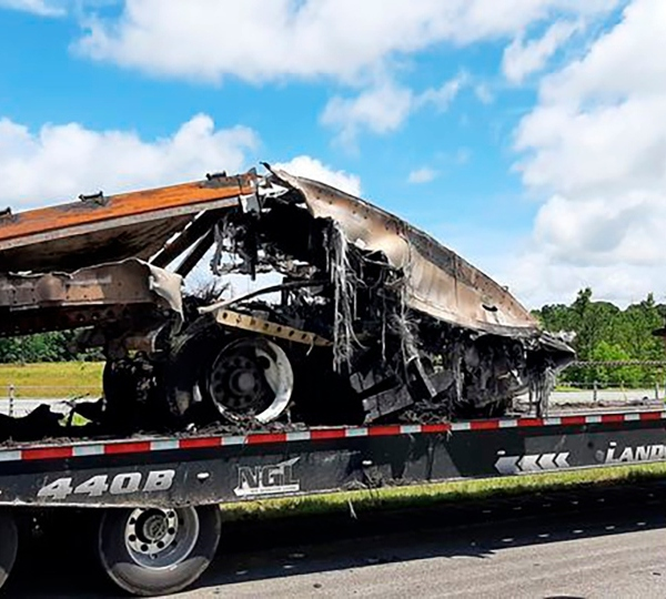 Some of the wreckage from a fatal multiple-vehicle crash a day earlier is loaded to be carried away, Sunday, June 20, 2021, in Butler County, Ala.