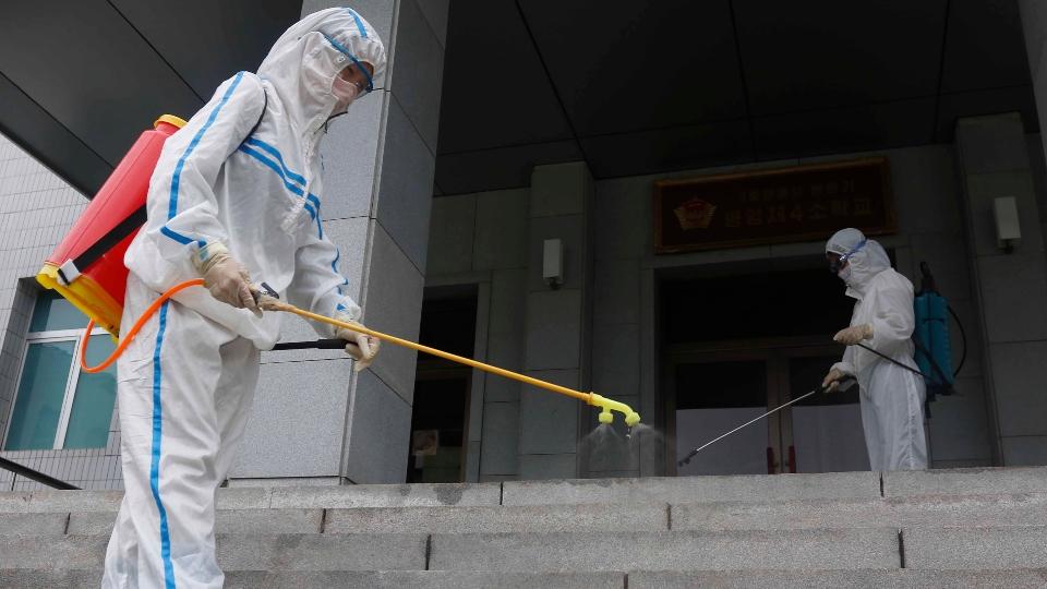 Staff of the Pyongyang Primary School No. 4 spray disinfectant in Pyongyang, North Korea, Wednesday, June 30, 2021.