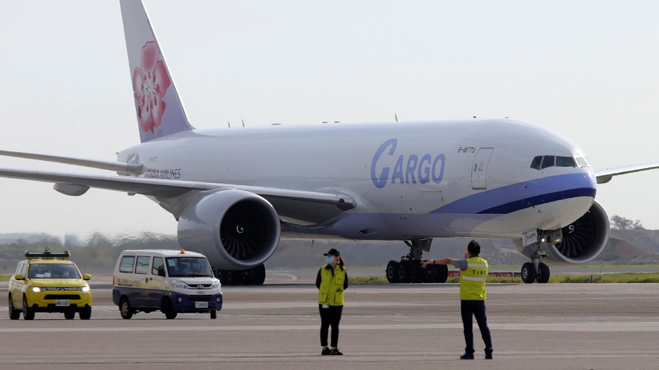 In this photo released by the Taiwan Centers for Disease Control, a China Airlines cargo plane carrying COVID-19 vaccines from Memphis arrive at the airport outside Taipei, Taiwan, Sunday, June 20, 2021.