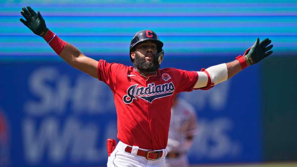 Cleveland Indians' Amed Rosario celebrates after hitting a solo home run in the first inning of the first baseball game of a doubleheader against the Chicago White Sox, Monday, May 31, 2021, in Cleveland. (AP Photo/Tony Dejak)