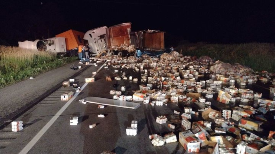 Boxes of juice spill onto I-80 after three tractor-trailers crash, westbound lanes close