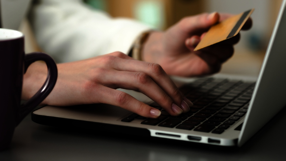 Close up view of businesswoman hands holding credit card