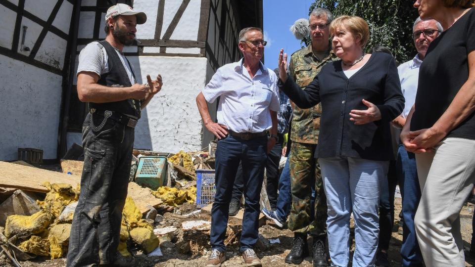 German Chancellor Merkel tours 'surreal' flood scene, vows aid, climate action