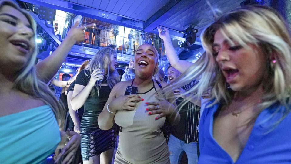 Mixed feelings, Johnson in quarantine mar UK's 'freedom day'
