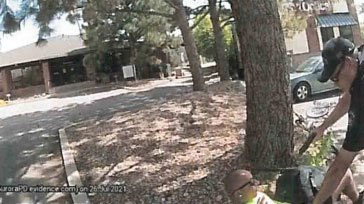 Body camera footage still image from Aurora Police Department probable cause affidavit.
