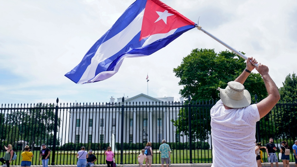 People participate in a rally outside the White House in Washington, Tuesday, July 13, 2021, in support of the protesters in Cuba.