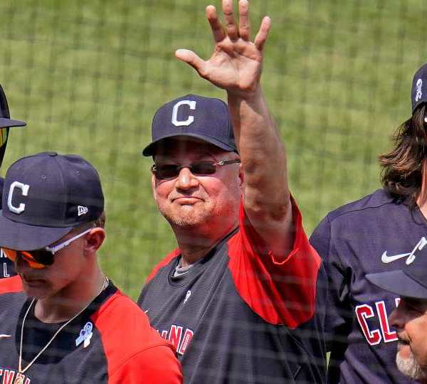 Cleveland Indians manager Terry Francona, center, waves to fans after getting a win over the Pittsburgh Pirates in a baseball game in Pittsburgh, Sunday, June 20, 2021.