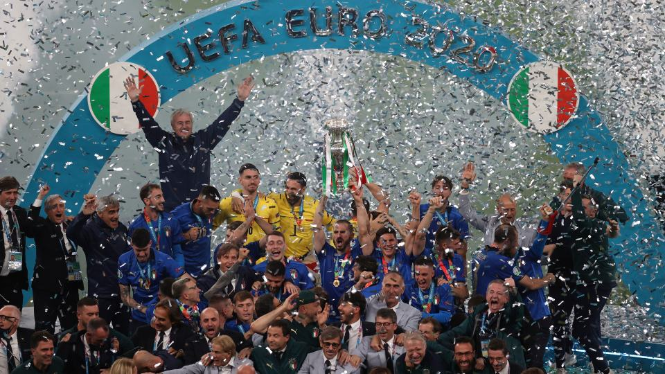 Italian team celebrates with the trophy after the Euro 2020 soccer final match between England and Italy at Wembley stadium in London, Sunday, July 11, 2021. (Catherine Ivill/Pool via AP)