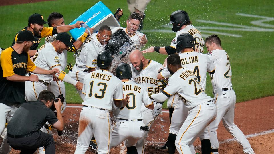 Pittsburgh Pirates' Jacob Stallings (58) celebrates with teammates after hitting a walkoff grand slam off New York Mets relief pitcher Edwin Diaz during the ninth inning of a baseball game in Pittsburgh, Saturday, July 17, 2021. (AP Photo/Gene J. Puskar)