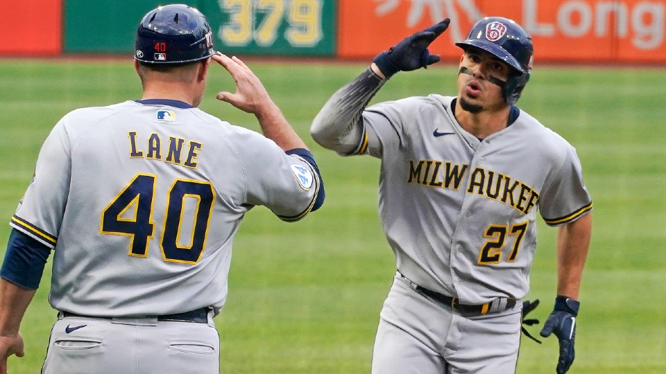 Milwaukee Brewers' Willy Adames and Jason Lane