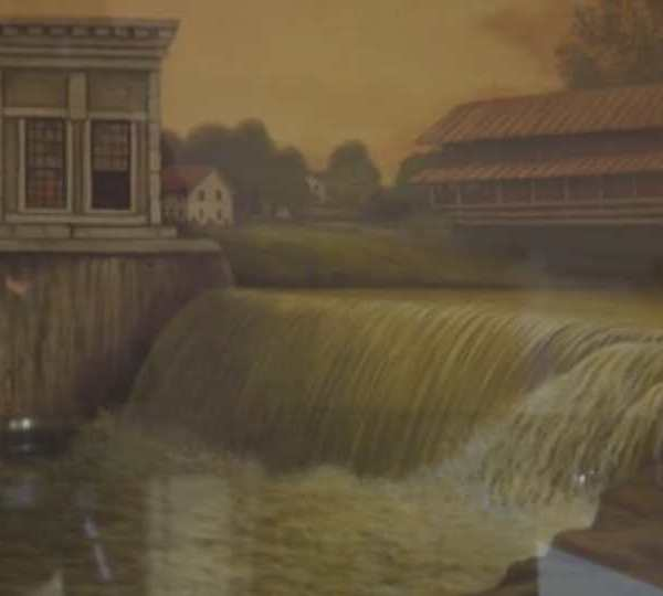 David Lynch of Newton Falls showed off a painting of the West Branch Bridge from 1926, which is the same one that lies along State Route 534.