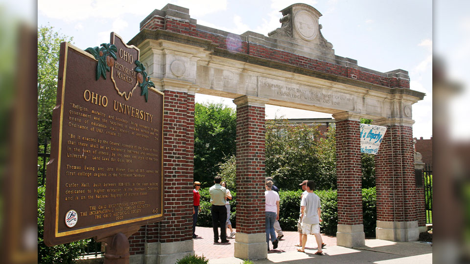 This June 12, 2006 file photo shows a gate with a historic marker on the Ohio University campus in Athens, Ohio. A week after the state enacted an anti-hazing law in honor of an Ohio University student who died in 2018, the university suspended another fraternity for allegedly violating hazing rules. The southeast Ohio university sent the school's Beta Chapter of Delta Tau Delta a notice Tuesday, July 13, 2021 that it will be suspended for four years.