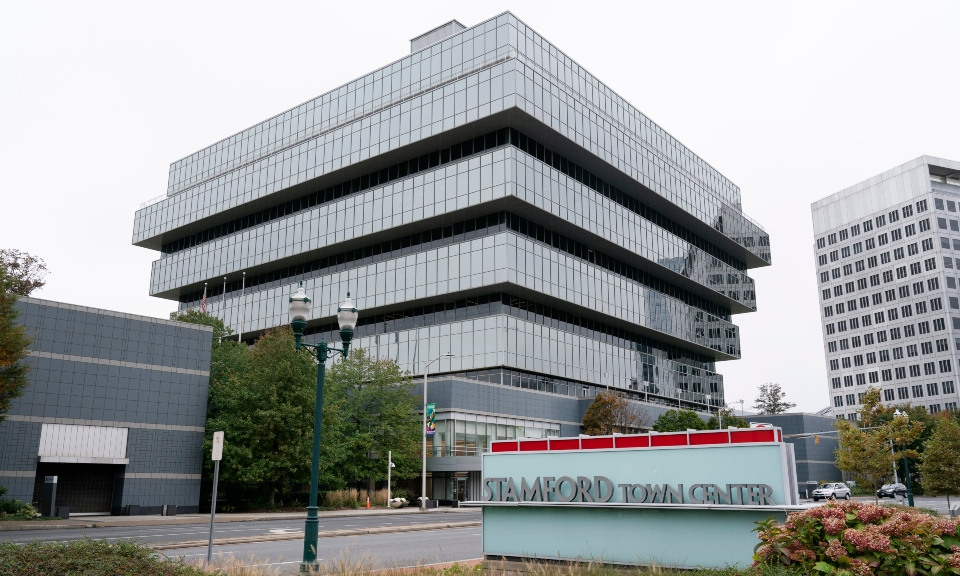 FILE - In this Oct. 21, 2020, file photo, Purdue Pharma headquarters stands in Stamford, Conn. In an agreement disclosed late Wednesday, July 7, 2021, in a filing in U.S. Bankruptcy Court in White Plains, N.Y., more than a dozen states have dropped their objections to OxyContin maker Purdue Pharma's reorganization plan, edging the company closer to resolving its bankruptcy case. (AP Photo/Mark Lennihan, File)