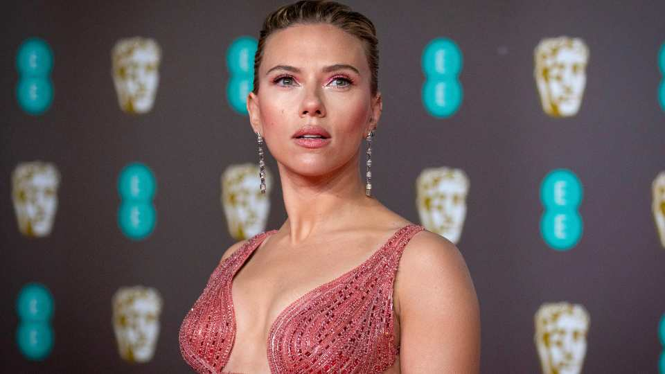 """Scarlett Johansson arrives at the Bafta Film Awards, in central London, Feb. 2 2020. Johansson is suing the Walt Disney Co. over the company's streaming release of """"Black Widow,"""" which she said breached her contract and deprived her of potential earnings. The """"Black Widow"""" star and executive producer filed a suit Thursday, July 29, 2021, in the Los Angeles Superior Court that said her contract guaranteed an exclusive theatrical release."""