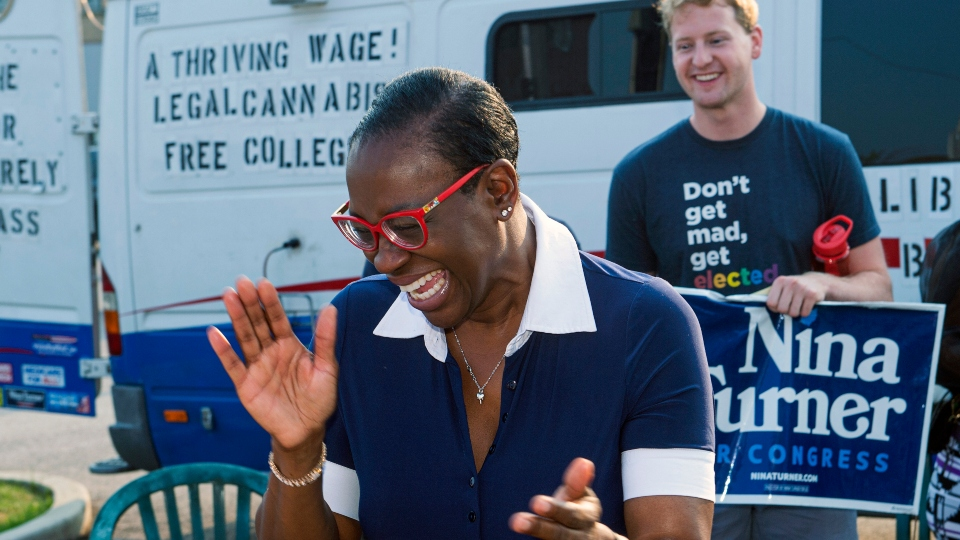 In this July 7, 2021, photo Nina Turner, a candidate running in a special Democratic primary election for Ohio's 11th Congressional District reacts as she speaks with supporters near the Cuyahoga County Board of Elections before casting her vote in Cleveland.