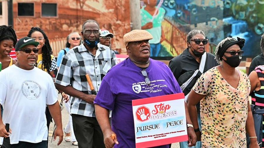 Marchers in the Stop The Violence Prayer Walk Saturday walk down Glenwood Avenue at the start of the walk, where prayers were offered to stop the violence in the city that has seen 74 people shot so far this year. (WKBN Photo/Joe Gorman)