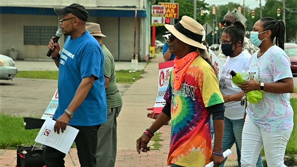Rev. Kenneth Simon, front, pastor of New Bethel Baptist Church, leads the group of Stop The Violence prayer marchers today from Glenwood Avenue to Sherwood Avenue. Marchers offered prayers to help stop a wave of violence in the city this year that has killed 17 people and wounded 57 more. (WKBN Photo/Joe Gorman)