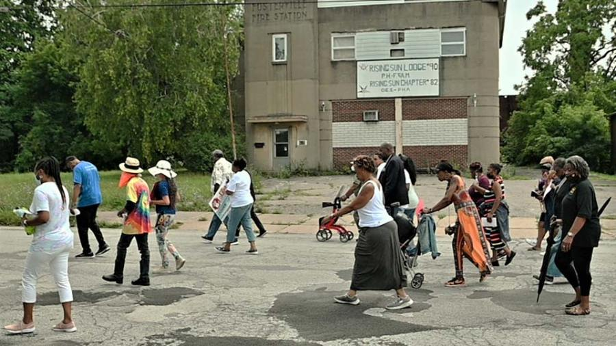 Marchers Saturday trek past the former Fosterville Fire Station on Sherwood Avenue during the Stop The Violence Prayer Walk on the South Side of Youngstown. (WKBN Photo/Joe Gorman)