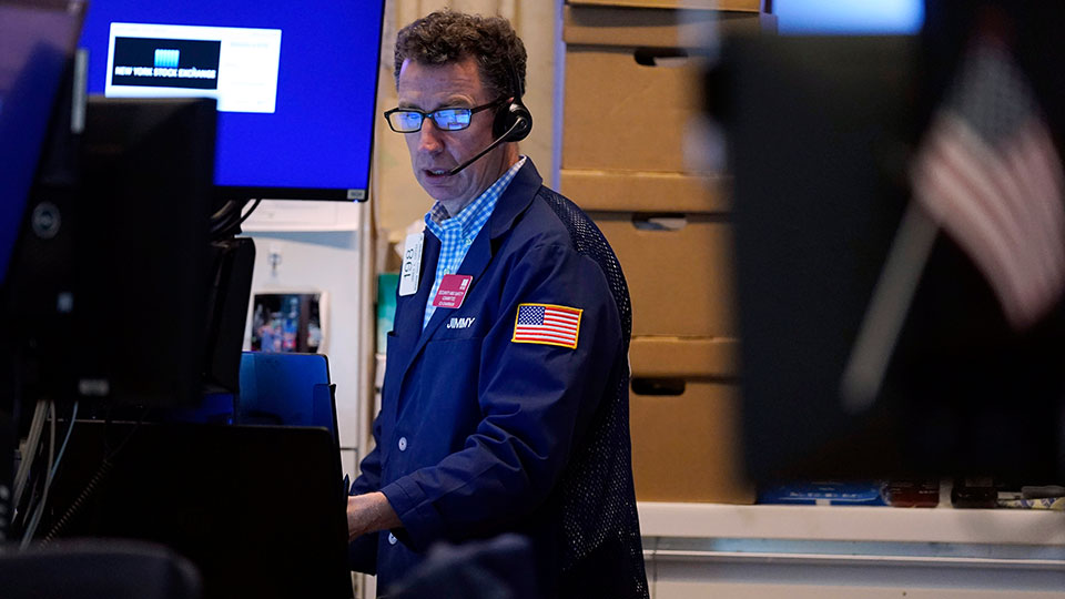 A trader works in his booth on the floor of the New York Stock Exchange, Monday, July 12, 2021.