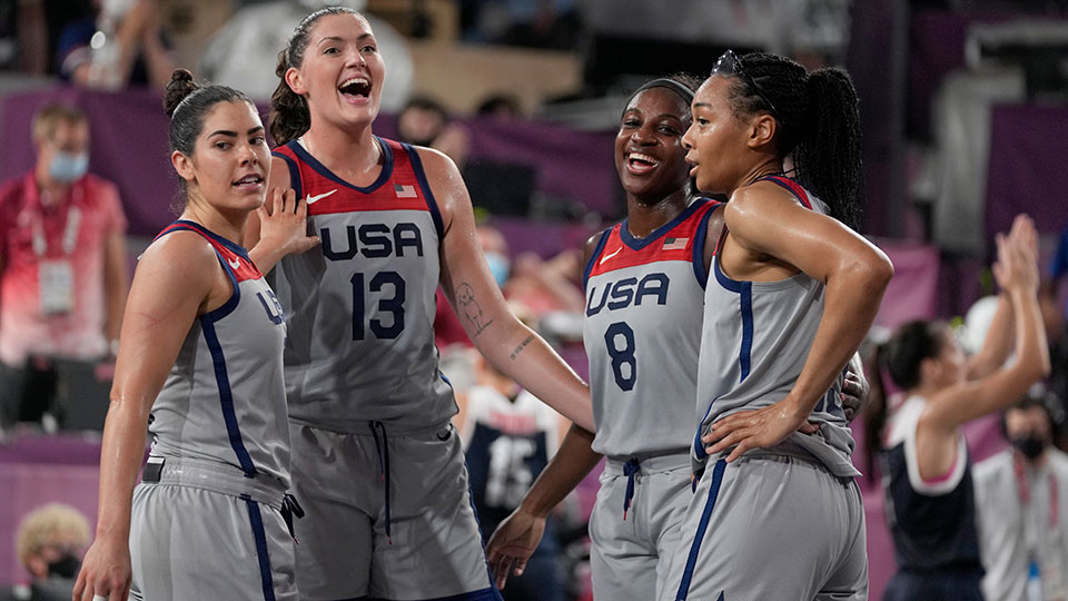 United States' Kelsey Plum, left, Stefanie Dolson (13), Jacquelyn Young (8) and Allisha Gray celebrate after defeating Russian Olympic Committee in a women's 3-on-3 gold medal basketball game at the 2020 Summer Olympics, Wednesday, July 28, 2021, in Tokyo, Japan