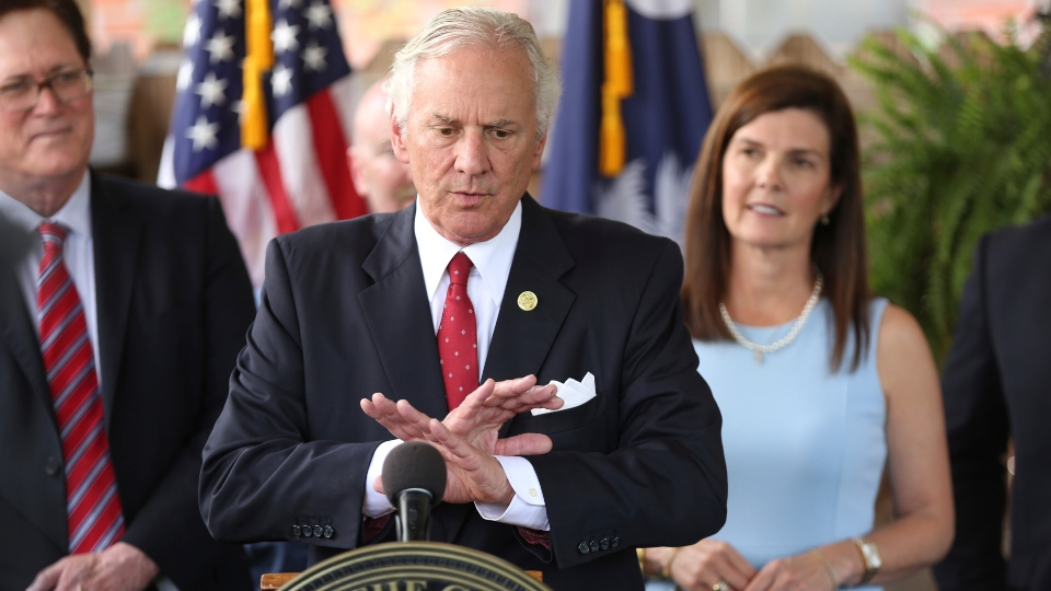 In this June 24, 2021, file photo, South Carolina Gov. Henry McMaster speaks during a ceremony to sign a bill preventing people from suing businesses over COVID-19 on Thursday, at Cafe Strudel in West Columbia, S.C.