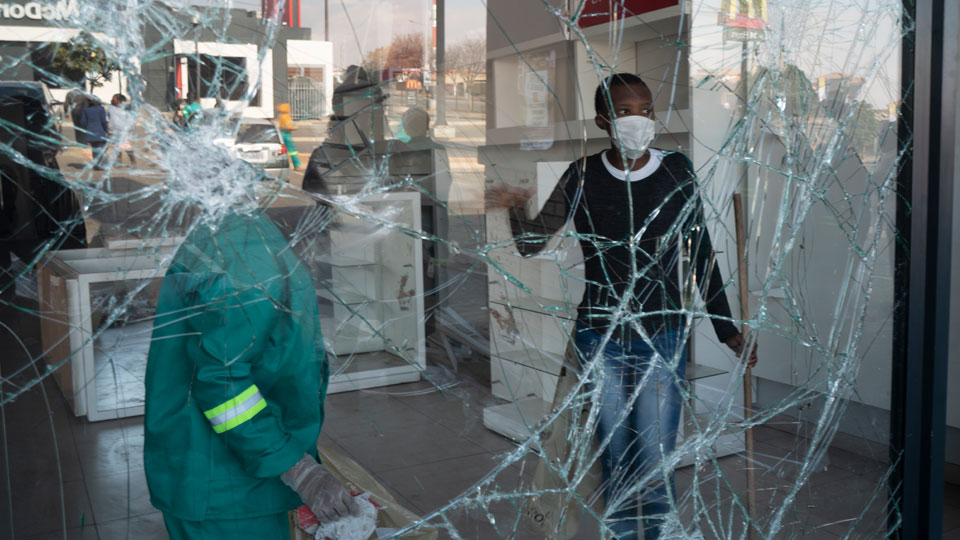 Volunteers participate in the cleaning efforts at Soweto's Diepkloof mall outside Johannesburg, South Africa