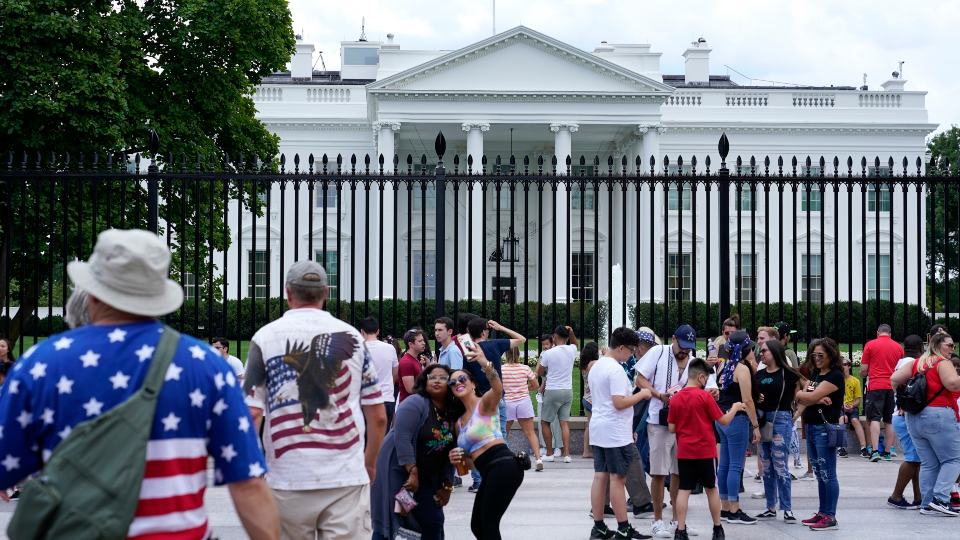 People gather on a section of Pennsylvania Avenue that was reopened to the public in front of the White House, Sunday, July 4, 2021, in Washington. (AP Photo/Patrick Semansky)