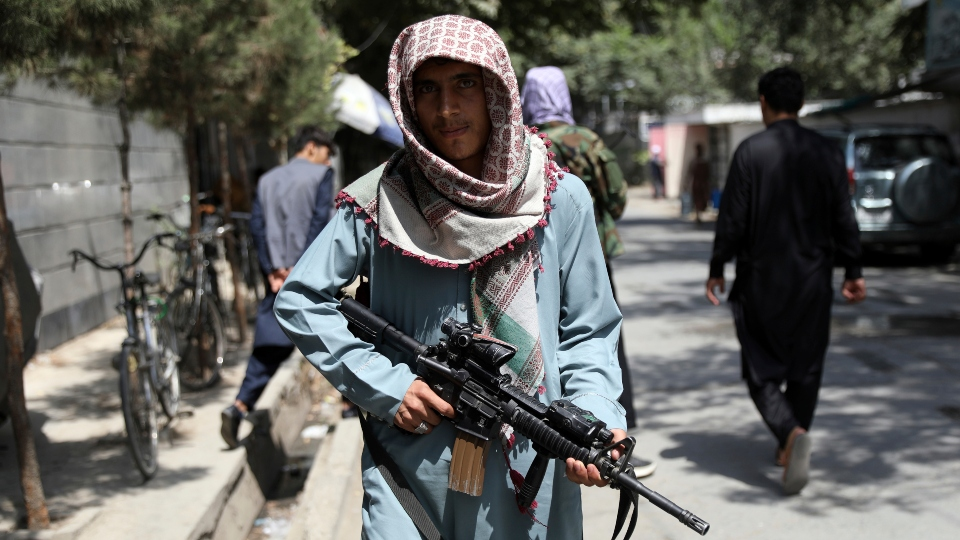 7 killed at Kabul airport; fighters seize areas from Taliban