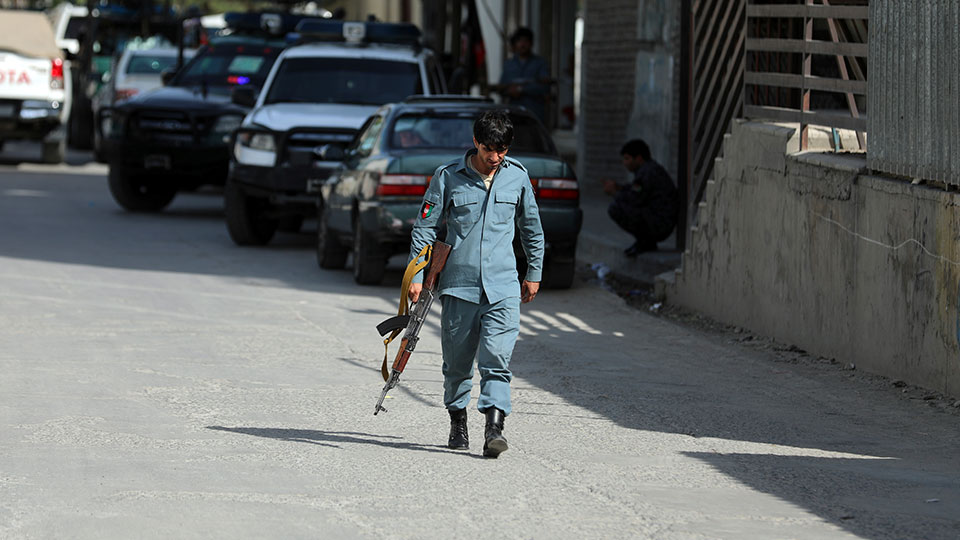 Afghan security personnel arrives at the area where the director of Afghanistan's Government Information Media Center Dawa Khan Menapal was shot dead in Kabul, Afghanistan, Friday, Aug. 6, 2021