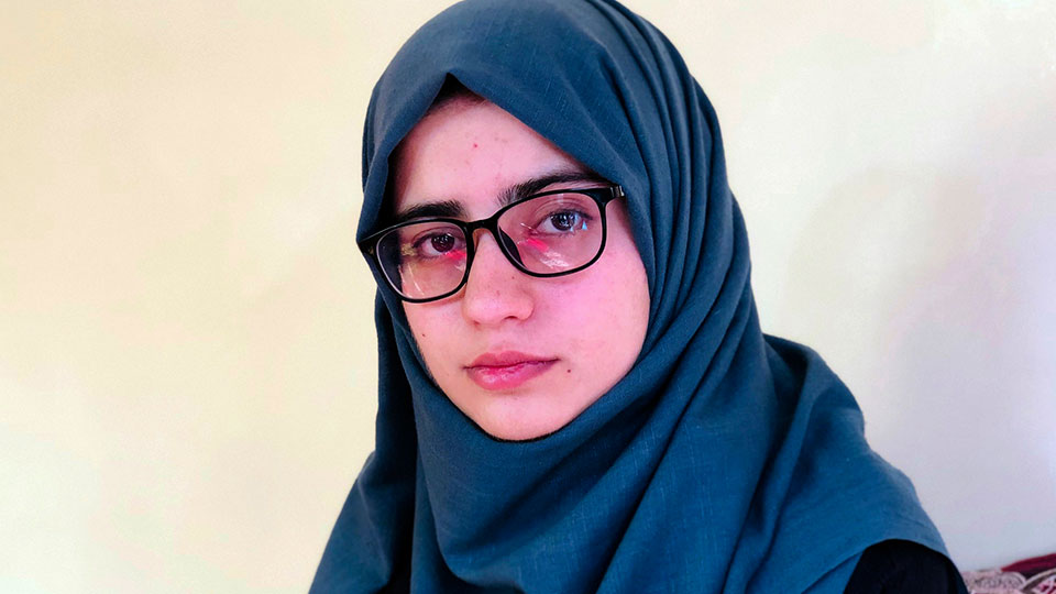 Salgy Baran, 18, who received the highest the highest score in the entire country on Afghanistan's university entrance exams this year, poses for photograph inside her home in Kabul, Afghanistan, Thursday, Aug. 26, 2021