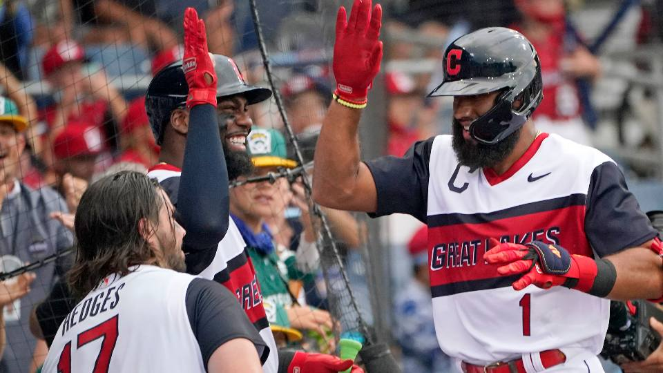 Cleveland Indians' Amed Rosario (1) celebrates as he returns to the dugout after after hitting a two-run home run off Los Angeles Angels starting pitcher Jose Suarezm during the first inning of the Little League Classic baseball game at Bowman Stadium in Williamsport, Pa., Sunday, Aug. 22, 2021.