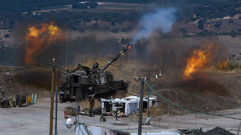 Israeli forces fire artillery from their position on the border with Lebanon after a barrage of rockets were fired from Lebanon, Friday, Aug. 6, 2021