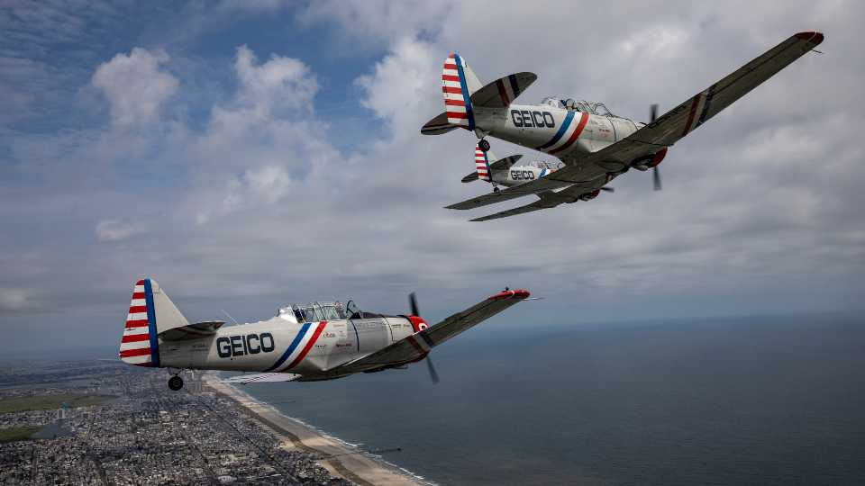 The GEICO Skytypers Air Show Team fly T-6 Texan planes over Atlantic City, N.J., during a media tour and flight on Monday, Aug. 16, 2021. A GEICO Skytypers plane that was due to take part in an upcoming air show crashed shortly after takeoff, Friday, Aug. 20, 201, at the Wilkes-Barre/Scranton International Airport in eastern Pennsylvania, killing the pilot.