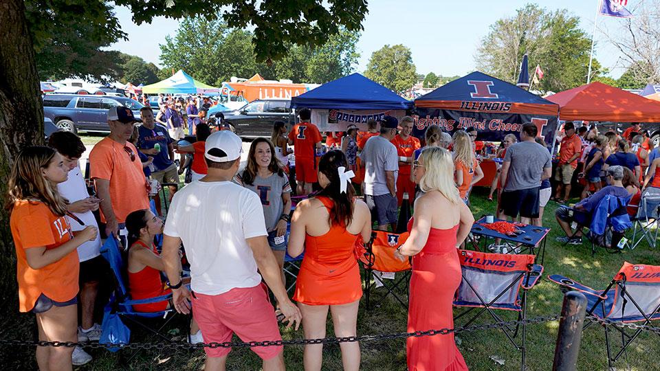 Illinois football fans tailgate before an NCAA college football game between Illinois and Nebraska on Saturday, Aug. 28, 2021