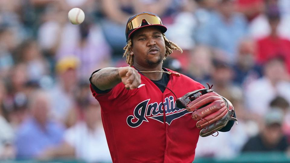 Cleveland Indians' Jose Ramirez throws out Boston Red Sox's Travis Shaw at first base after a bunt in the seventh inning of a baseball game, Saturday, Aug. 28, 2021, in Cleveland. (AP Photo/Tony Dejak)