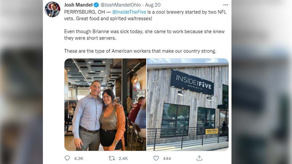 Josh Mandel is pictured in his tweet hugging a waitress who said she was sick and came to work.