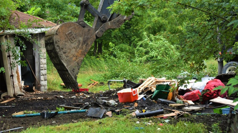 The back yard of this 166 W. Earle Ave. home on the South Side of Youngstown was crammed with debris until the city came and cleaned it up Thursday. The home is being demolished because it is a health hazard.