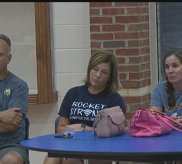Lowellville parents at school meeting
