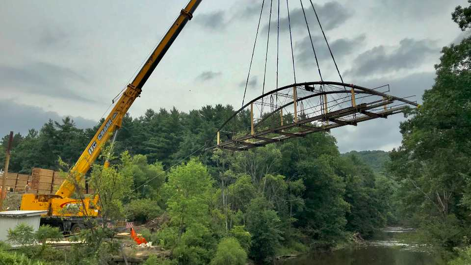 The historic Messerall Truss Bridge in Oil Creek Township, Crawford County was moved by crane on Tuesday, August 10, so it can be refurbished and repurposed as part of the multi-purpose trail project in Pymatuning State Park.