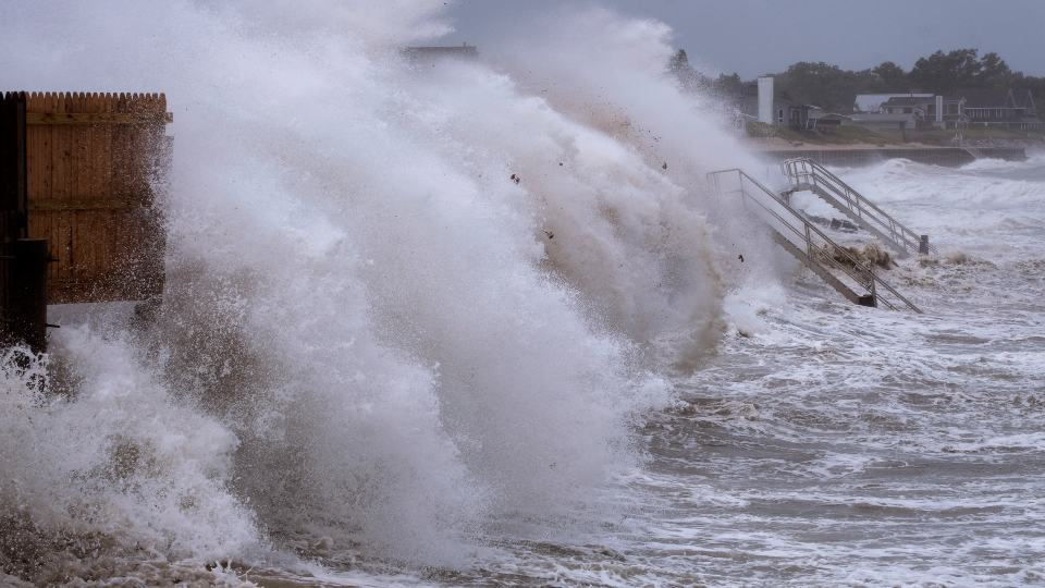 Waves pound the seawall in Montauk, N.Y., Sunday, Aug. 22, 2021, as Tropical Storm Henri affects the Atlantic coast. (AP Photo/Craig Ruttle)