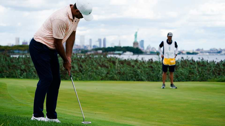 Brooks Koepka putts on the on the 14th green in the final round at The Northern Trust golf tournament at Liberty National Golf Course Monday, Aug. 23, 2021, in Jersey City, N.J.