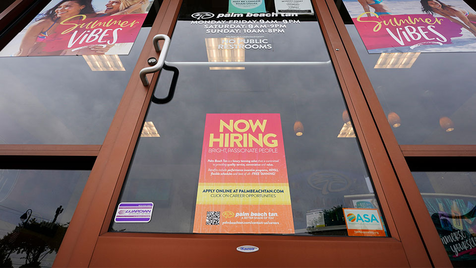 A Now Hiring sign at a business in Richmond, Va., Wednesday, June 2, 2021