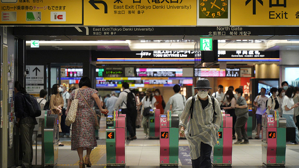 Passengers pass through the gates of a subway station in Tokyo, Friday, Aug. 6, 2021