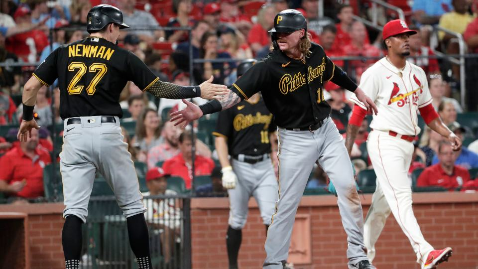 Pittsburgh Pirates' Ben Gamel (18) celebrates with Kevin Newman (27) after they scored on a single by Ke'Bryan Hayes, as St. Louis Cardinals relief pitcher Genesis Cabrera walks back to the mound during the seventh inning of a baseball game Saturday, Aug. 21, 2021, in St. Louis. (AP Photo/Tom Gannam)
