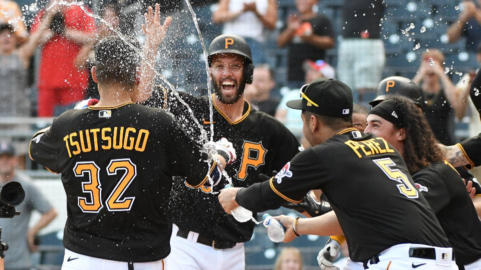 Pittsburgh Pirates players celebrate a three-run walkoff home run in the ninth inning by Yoshi Tsutsugo against the St. Louis Cardinals in a baseball game Sunday, Aug. 29, 2021, in Pittsburgh.